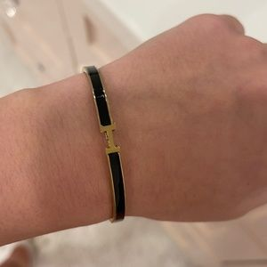 Hermès black and gold bracelet